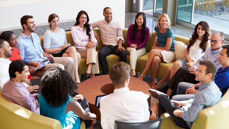 31047519 - multi-cultural office staff sitting having meeting together